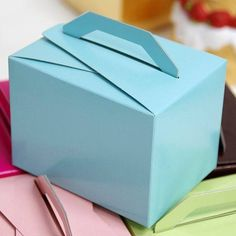 100 PCS Turquoise Tote Favor Boxes Bridal Shower Party Favor Gift Container / This shinning favor box is made of embossed cardboard.  Its elegant color and classic design allows you to present your charming favors with grace. Each side is tapered for an exquisite and decorative appearance. This box is the ideal size for holding slightly larger favors, like candle, or even a piece of cake.  Boxes arrive flat-packed, and can be assembled in a snap.