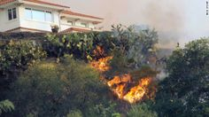 California fights wildfire, expects more as drought emergency declared~ The fire makes it way up a hill toward a house in Glendora on January 16, 2014.