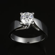 Classic diamond solitaire with contemporary bypass split band. A different twist on the classic 4 prong diamond solitaire for a more unique look.