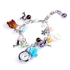 Descriptions: Elegance appearance Fancy corlorful pendants decorated bracelet was one of the element of this watch. Precise Japan Quartz movement for a. Cute Bracelets, Fashion Bracelets, Bangle Bracelets, Bracelet Watch, Bangles, Quartz Watch, Jewelery, Jewelry Accessories, Bling
