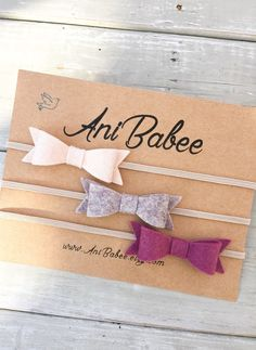 Mulberry, Cream and Heather Gray Felt Bow Headband Set, Felt Bows Measures approximately 2 x .75 and is attached to a 1/8 skinny elastic band. **Listing