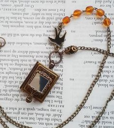 Victorian Spooky Haunted Mirror Book Locket Black Bird Orange Beads Hanging Charms Jewelry Necklace by DreamAddict on Etsy