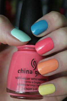 Multi-coloured Rainbow Nails by coewlesspolish