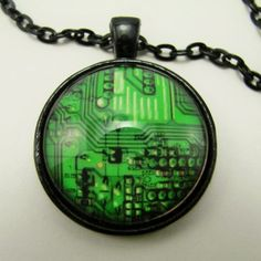 Circuit board necklace celebrating the beauty of technology. Great gift for guys and gals with a passion for electronics.  The image is covered by a