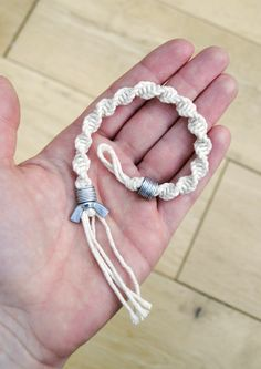 this would be a really cool fancy version of a friendship bracelet.  Done with different coloured string or beads it leaves endless hours of bracelet making in the backyard
