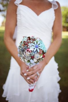 Brooch bouquet made out of vintage brooches and jewelry. www.theritzyrose.com $475