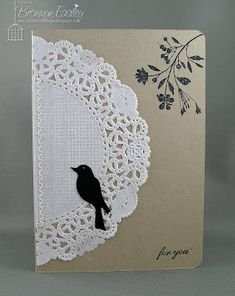 doily on a plain journal + black-ink sketches. simple gift idea
