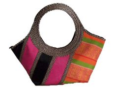 HAND-BAG MADE FROM WOVEN ARROW CANE AND YAKAR LIKE FABRIC.