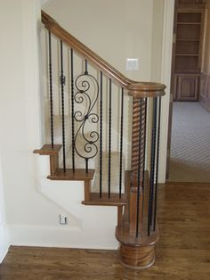 This staircase design was created using Twist series balusters. The single twist baluster (16.1.21) and the spiraled scroll baluster (16.1.25) are paired to create a uniquely designed staircase. These components are available in Satin Black (shown), Silver Vein, Copper Vein, Oil Rubbed Bronze, and Oil Rubbed Copper and Antique Nickel. We offer parts, install services, and custom components throughout Texas. Click the image for more information.