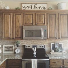 Before I call it a night I want to share some I received earlier this week. I was so blessed to win this beautiful gather sign… Before I call it a night I want to share some I received earlier this week. I was so blessed to win this beautiful gather sign… Above Cupboard Decor, Top Of Cabinet Decor, Decorating Above Kitchen Cabinets, Above Cabinets, Cabinet Top Decorating, Top Of Cabinets, Farmhouse Kitchen Decor, Kitchen Redo, Kitchen Cupboards