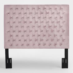 Elevate your bedroom decor with our blush pink headboard featuring diamond tufting and smooth velvet-like upholstery for a sophisticated edge.