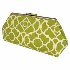 "Clutch with a green trellis motif. Handmade in the USA.   Product: ClutchConstruction Material: Cotton outer fabric, nickel frame and faux silk interior liningColor: Green and off-white    Features: Beautifully handmade in the USAFaux silk contrast liningPerfect for holding  phone, cash, or makeup Dimensions: 5"" H x 10"" W x 2.5"" D Cleaning and Care: Spot clean"