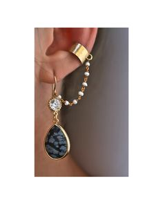 LOVE THESE! Dangle Cuff: Victorian inspired dangle ear cuff set. These amazing earrings feature two large drops of natural snowflake obsidian stone framed in 16k gold-plated, two high quality gorgeous sparkling vintage crystals, genuine freshwater pearl wire-wrapped chain, and a hammered satin finished gold ear cuff @JewelMint