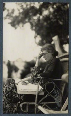 Virginia Woolf working; photo taken by Lady Ottoline Morrell in 1926. (National Portrait Gallery)
