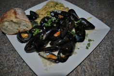 Steamed mussels in a creamy garlic sauce. Delicious.