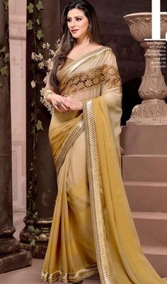 Unleash the exuberance in you by draping on this cream and brown color chiffon embroidered saree. This engaging saree is showing some superb embroidery done with resham and lace work. Upon request we can make round front/back neck and short 6 inches sleeves regular sari blouse also. #prettysaridesign #creamcolorsaree #trendysaris