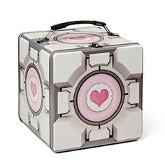 "From ThinkGeek: ""Someone bumps into you and you slip, launching your precious Portal 2 Companion Cube Tin Lunch Box skyward. Don't fret, it's made of durable tin and as it meets the concrete, it may get a bit scratched up, but its contents are safe and sound and ready to be picked back up and loved, at least until you gnash them with your teeth."" Only $14.99"