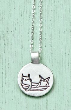 Owl and the Pussycat necklace: Inspired by the classic poem by Edward Lear. It's a story of the love between the title characters who sail away together and marry on their adventure.
