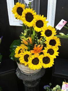 Beautiful sunflower arrangement! Make sure to call us or stop in for any custom arrangements you need :)