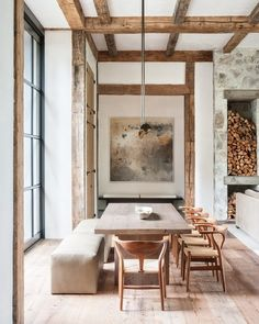 A dining room by D. Stanley Dixon Architect | Contemporary Barn.