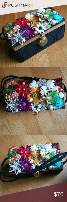 Vintage purse up cycled enamel flower accents Handmade 1950's fabric bag decorated with a garden theme using vintage jewelry including:   Enamel flower brooches   Vintage spider   Vintage buttons Clasp is secure Double handles Inside shows some wear Fabulous vintage wearable art! Handmade Bags Totes