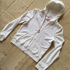 PINK by Victoria's Secret Zip Up Hooded Swearshirt PINK by Victoria's Secret Zip Up Velour Hooded Sweatshirt . Size M. Soft white velour with pink dog zipper tag and front pockets with pink dog on bottom corner. 71% cotton/29% polyester. One VERY small spot on the sleeve(photo#4) but otherwise EXCELLENT used condition!! No trades. PINK Victoria's Secret Tops Sweatshirts & Hoodies