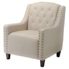 "Diamond-tufted arm chair with nailhead trim and wood frame.   Product: Arm chair  Construction Material: Wood and fabricColor: Espresso and beigeFeatures: Softly padded arms, back, and seatDimensions: 33.46"" H x 29.53"" W x 19"" D"