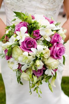 #Garden wedding bouquet. #Purple roses, orchids, #green tea roses.