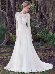 Maggie Sottero - DEIRDRE, Understated elegance is found in this subtle lace and Santorini chiffon A-line wedding dress, complete with bateau neckline and long sleeves. Illusion lace details and stunning V-back create a sweet-yet-sexy style. Finished with zipper closure.