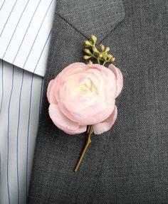 maybe with a peach ranunculus-groomsmen