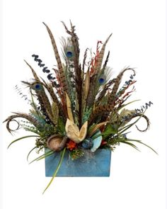 Turquoise Sugar Mold with Dried Floral Arrangement. Turquoise Tones with Peacock Feathers and Pheasant Feathers . One -Sided Floral Arrangement for a side table. Pheasant Feathers, Peacock Feathers, Sugar Mold, Fall Floral Arrangements, Small Centerpieces, Cow Horns, Faux Flowers, Dried Flowers, Flower Decorations