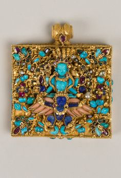 "Gold Amulet case. Hindu God Vishnu (carved turquoise) flying on winged (coral) Garuda (lapis lazuli) 17th–19th C. Nepal. rubies, sapphires, emeralds, pearls, zircon 2 1/2 x 2 1/4"""