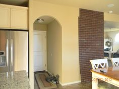 Home Is Where They Love You: DIY Faux Brick Wall Faux Brick Panels, Brick Paneling, Board And Batten, Basement Remodeling, Brick Wall, Tall Cabinet Storage, Interior, House, Furniture