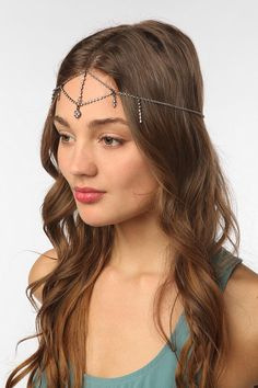 This Rhinestone Goddess Chain Headdress is from Urban Outfitters...  I am totally wearing it this weekend!!!