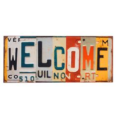 Welcome License plate-inspired wall art. need to talk to family and collect from all the states ... AK, AL, SC, NC, WA, ID,TX