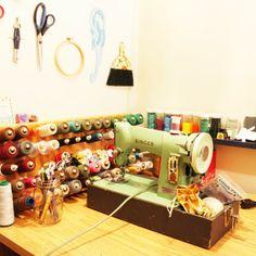 green sewing machine and colourful bobbins - rousskine