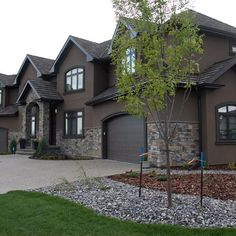 Dark Colored Stucco Home Owner Project In Mclauhan Bluff Browse This Edmonton Builder Portfolio Item And More At Met Exterior Stone