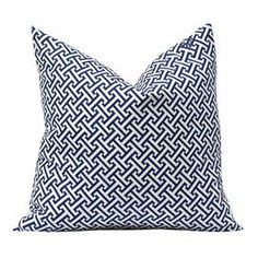 100% Cotton pillow with cross section motif and feather down fill.   Product: PillowConstruction Material: Cotton and feather down fillColor: Blue and whiteFeatures:  Zippered closureSame pattern on front and backInsert includedWill enhance any dcor  Dimensions: 20 x 20Cleaning and Care: Spot clean with gentle cleaner and air dry
