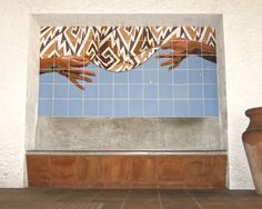 Project: Bench Niche Mural / Fairfax Branch Public Library - Julio Sims. For the Los Angeles Fairfax Branch Library, I combined cosmology, geometry, basketry and storytelling with Native American motifs and American Sign Language in two thematically related murals. An exterior ceramic tile mural sits above a built-in bench, harmonizing with the Spanish-style architecture, yet subtly addressing the region's legacy and still-present impact from European colonization. (A second digitally…