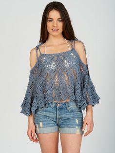 Crochet multipurpose top - worn here as an open shoulder poncho. By Anna Kosturova