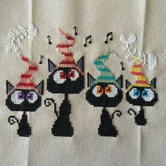 completed cross stitch Halloween Cats singing