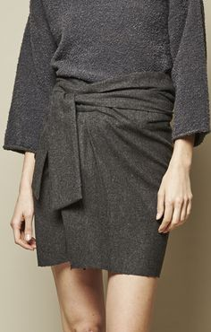 Achro belted wrap skirt is a short fitted skirt with wrap front, tie belt at…