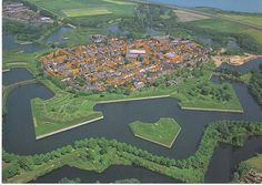 NAARDEN, NEDERLAND  Fortification city that evolved during 16th century.  Complete with walls, moats, etc.  One of the best preserved fortified towns in Europe today.