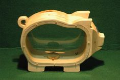 Wooden Piggy Bank by DWSudekum on Etsy, $22.50. I like that they can see the money as they save!
