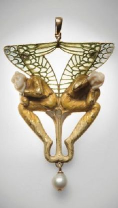 René Lalique - An Art Nouveau gold, pearl, ivory and enamel brooch, circa 1900. Representing two winged figures in Symbolist style, their heads in ivory, their bodies resting on a floral motif, the wings applied with plique-à-jour enamel, suspending a pearl, mounted in gold. Signed Lalique. Later transformed into a pendant. #Lalique #ArtNouveau #pendant