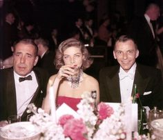 The Rat Pack, so named by Lauren Bacall, originally centered around Humphrey Bogart, not Frank Sinatra. Sinatra took over only after Bogie passed away. Here is a great shot of Bogie and Bacall with a very young Frank Sinatra.