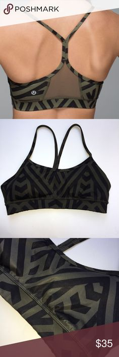 Lululemon Flow Y Bra IV size 4 Chevron Green Black Lululemon Flow Y Bra IV Chevron Shuffle Fatigue Green Black  cottony-soft Luon fabric is engineered for serious stretch and recovery this technical fabric is sweat-wicking four-way stretch added LYCRA® fibre moves with you and holds its shape lightweight Mesh panels are placed in high-sweat areas for added breathability thin straps allow you to move and twist with ease chafe-resistant elastic band under the bust provides support where you…