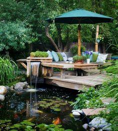 Tämä näin. Kiva terassi, kiva putous, kasvien siimeksessä, lumpeet... Healthy, blue water can be achieved with Organic Pond Products! www.organicpond.com