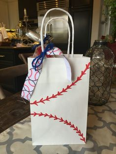 Cute and easy baseball bags I made for the team in a matter of minutes with a sharpie. #baseballtreats
