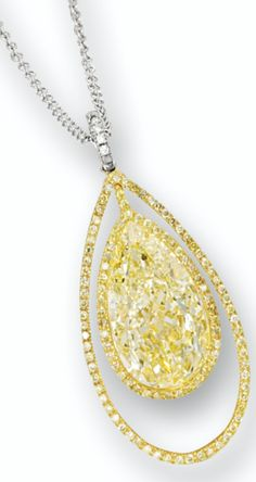 FANCY YELLOW DIAMOND AND DIAMOND PENDANT.        Suspending on an oscillating pear-shaped fancy yellow diamond weighing 11.88 carats, within a frame set with brilliant-cut yellow diamonds, to a hook surmount set with brilliant-cut diamonds, accompanied by a link chain, mounted in platinum and 18 karat gold, length approximately 400mm. Sotheby's.